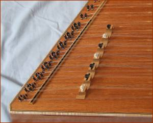 Picture of extra bass bridge on Chromatic series hammered dulcimer